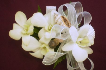 Image of shell and flower bridal corsage